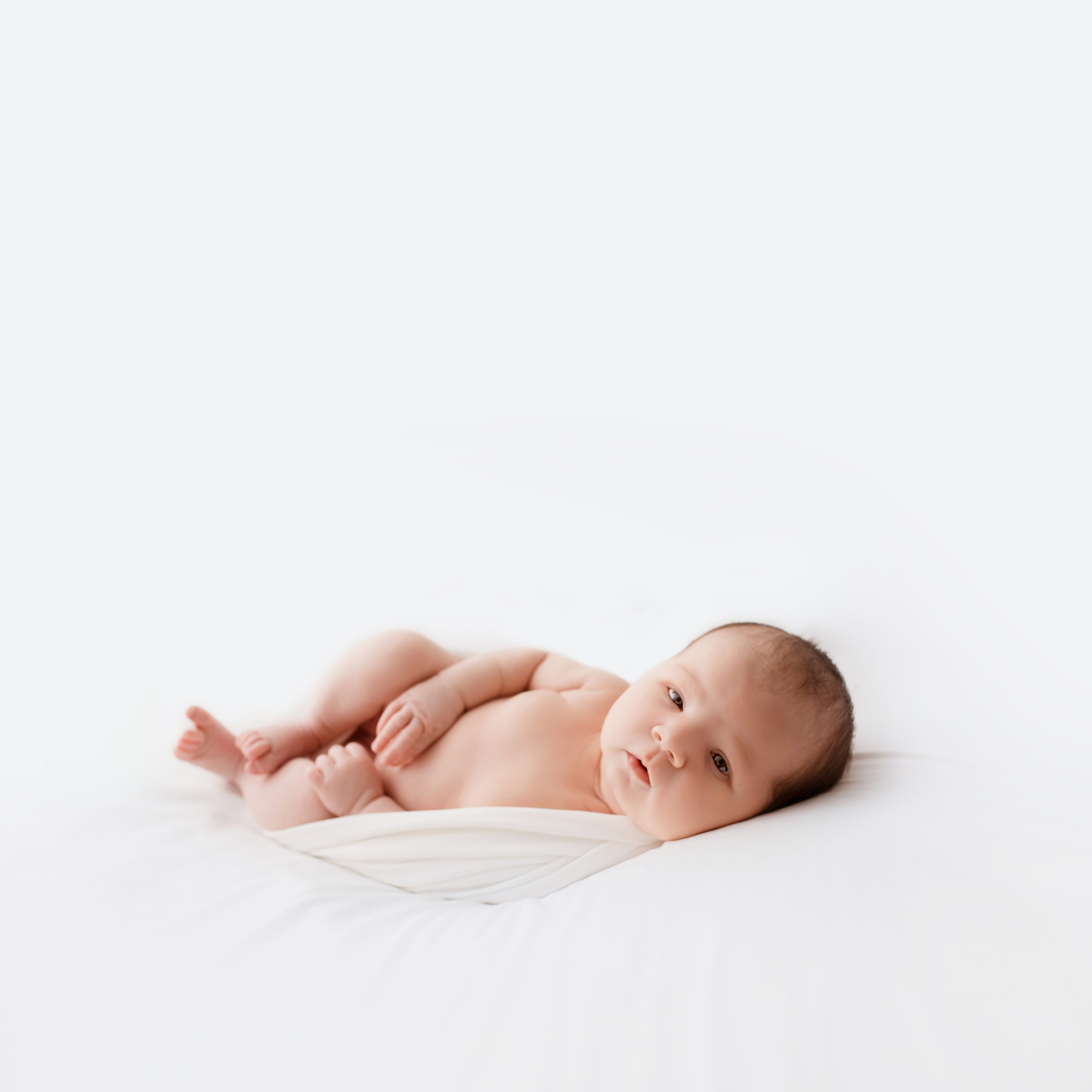 newborn photography session baby awake