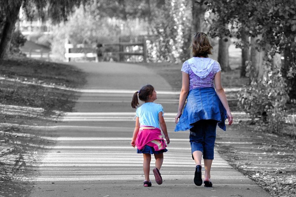 woman and daughter walking