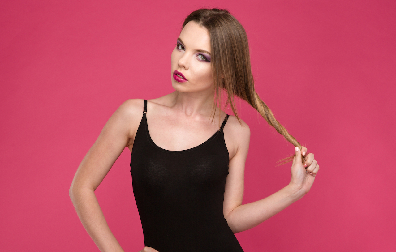 Fashion portrait of glamourous model playing with hair