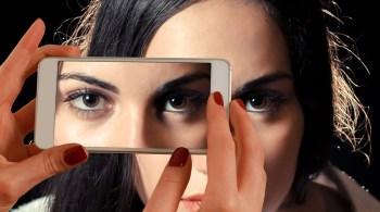 woman smartphone eyes