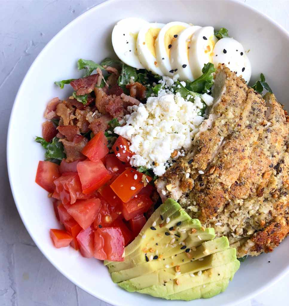 paleo bread crumbs shown in a Cobb salad