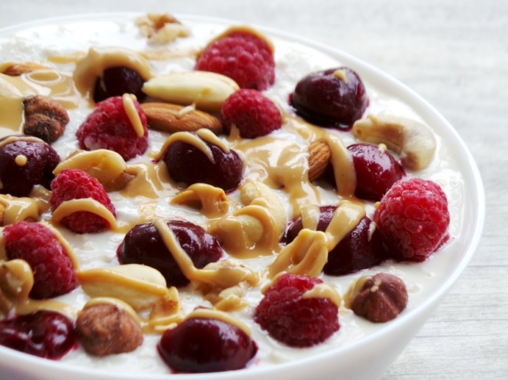 Overnight oats with yogurt - easy healthy breakfast recipe with cherries, berries, peanut butter and nuts! Also a good on the go breakfast idea!