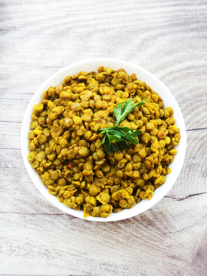 Easy and healthy lentil recipe! These spicy turmeric lentils are perfect in wraps or in salads, or wherever you think you might need lentils - these are super tasty and quick!