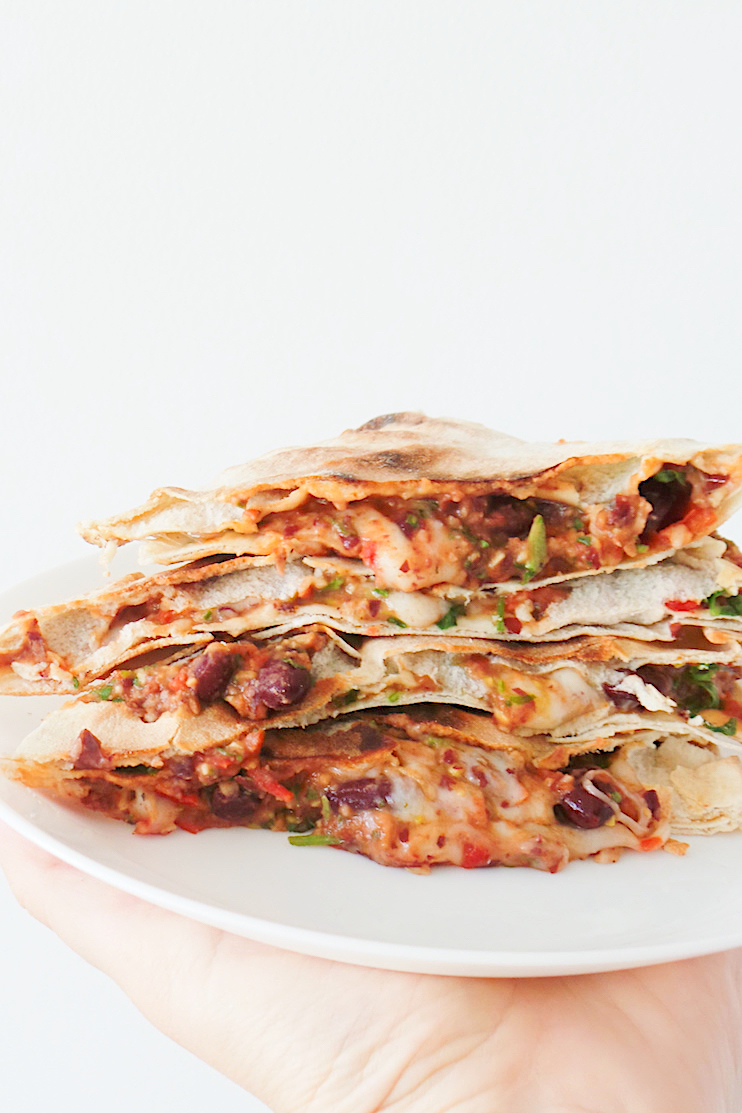 Healthy vegetarian quesadilla recipe with beans! The filling for this easy recipe is beans, vegetables, spices and some cheese! Super delicious and quick healthy lunch if you haven't made anything ahead and want to eat in like 10 minutes! Perfect for Meatless Mondays.   www.beautybites.org