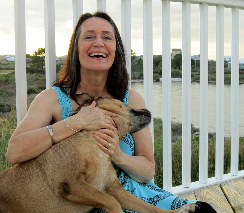 Older Woman Smiling Holding Her Dog Since Avoiding Makeup Mistakes Pixibay Image