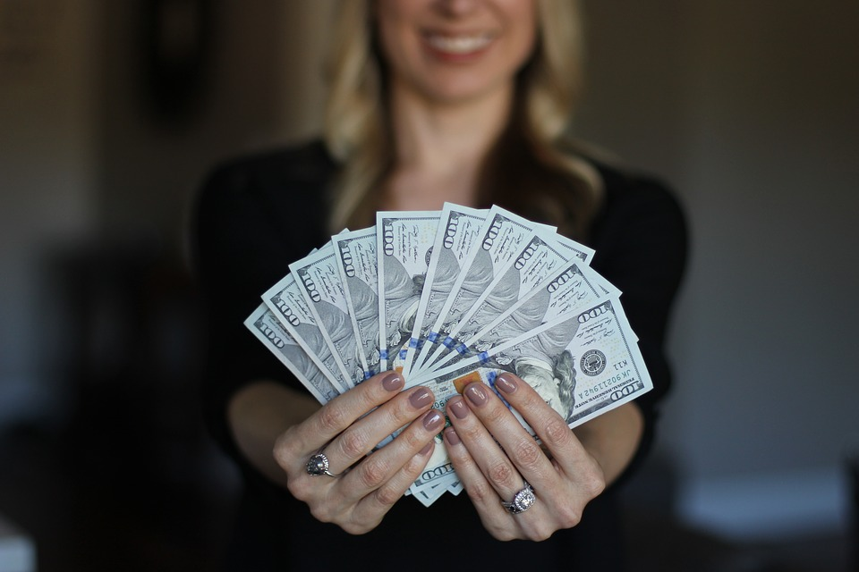 Smiling Woman Proudly Holding Lots of  Saved Money Pixibay Image