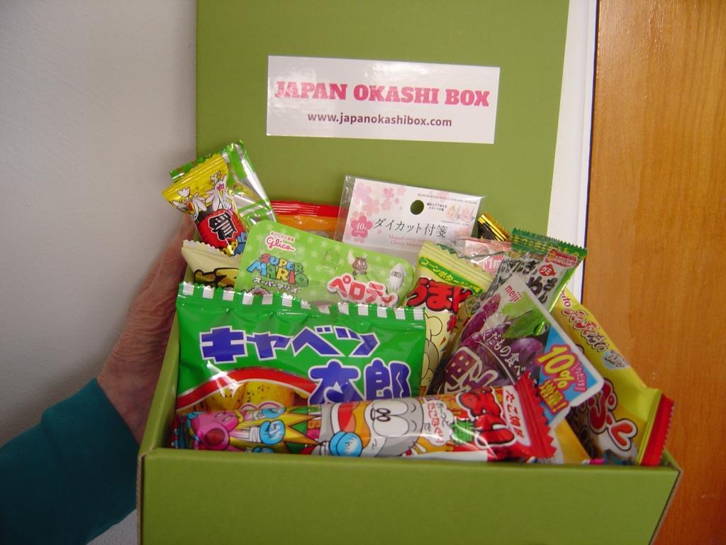 Japan Okashi Snack Box holding it near door