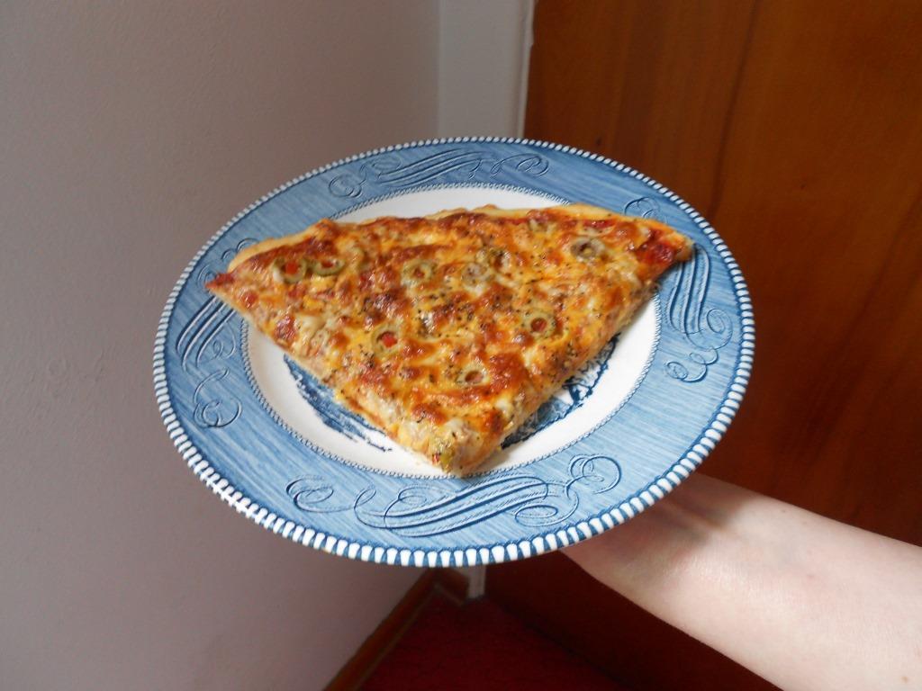 Mediterranean Tuna pizza slice