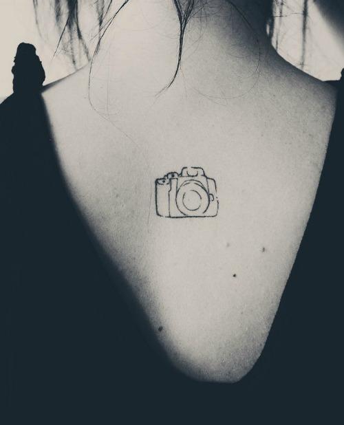 Tiny Camera Tattoo on Back