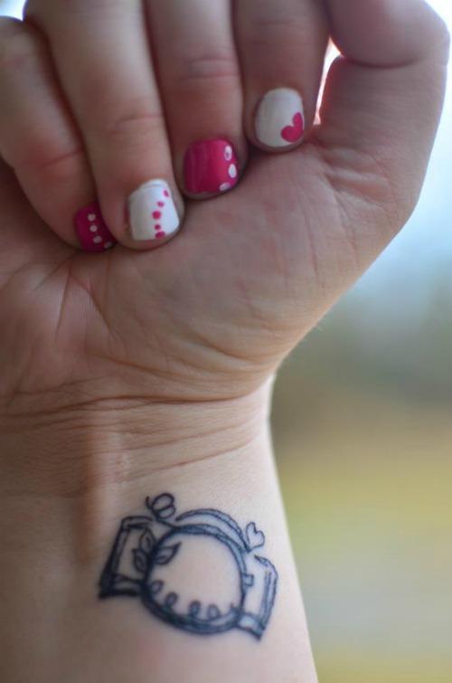 Tiny Camera Tattoo on Wrist