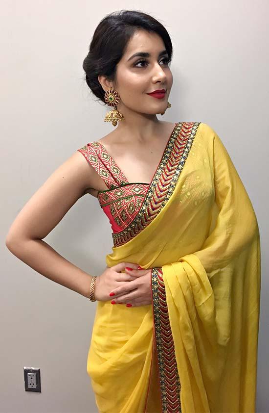 Rashi-Khanna-In-Yellow-Saree-Paired-With-Sleeveless-Blouse