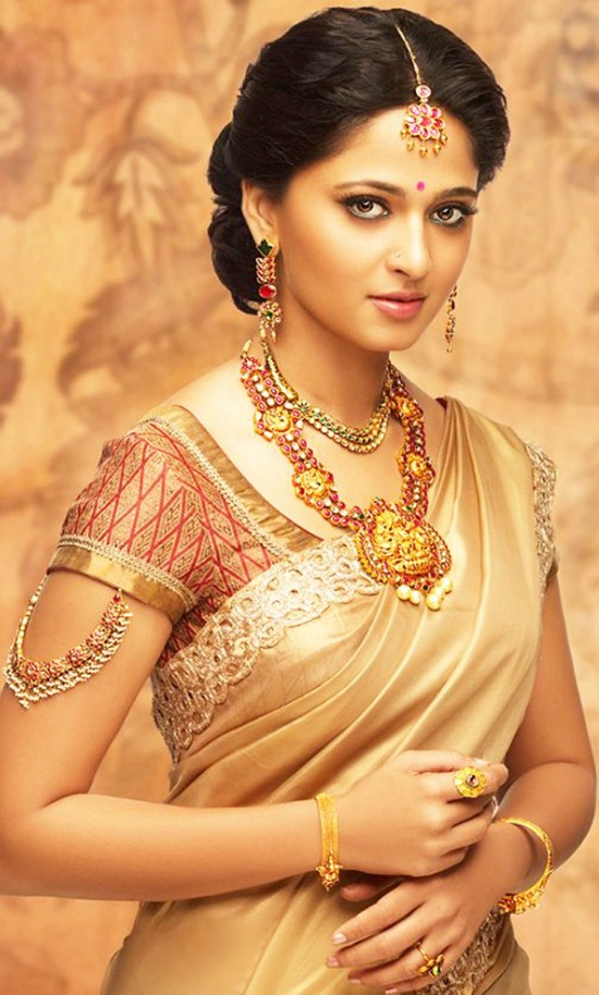 Plain Gold Saree And Matching Red And Gold Combination Blouse