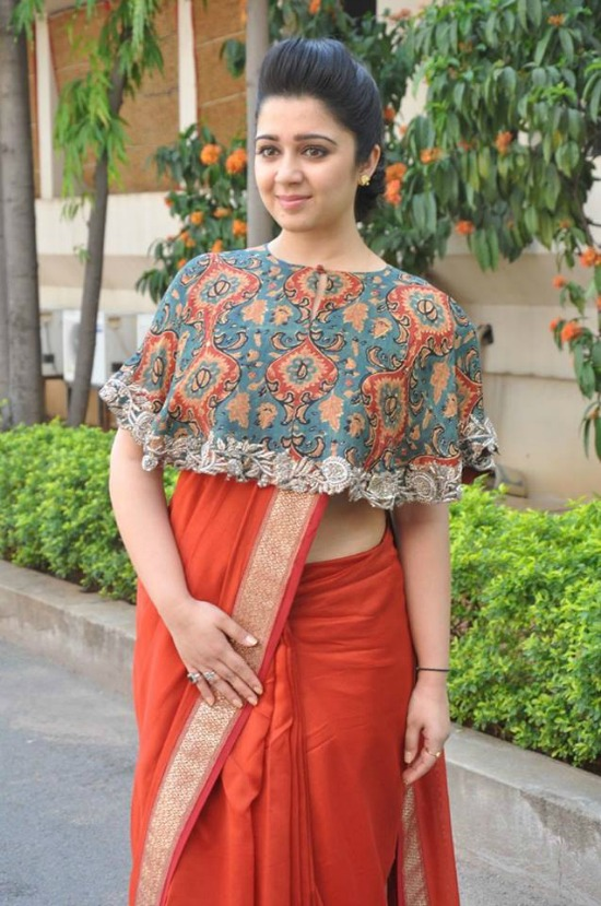 Charmy Kaur In Orange Saree With Crop Top Blouse
