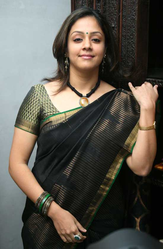 Jyothik with gold zari border in black silk saree