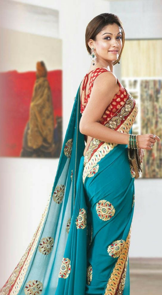 Nayantara In Ice Blue Embroidery Saree With Red Blouse