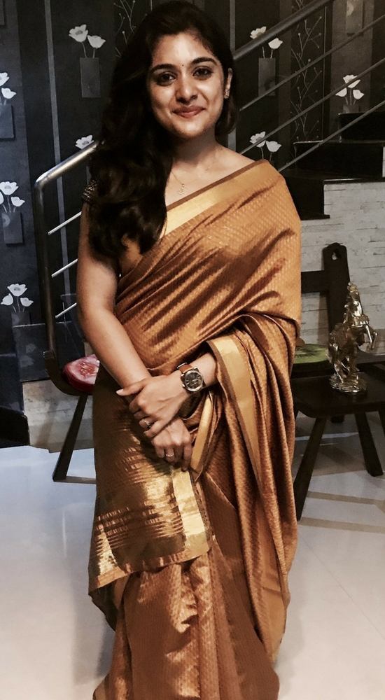 Niveda Thomas In Gold Saree