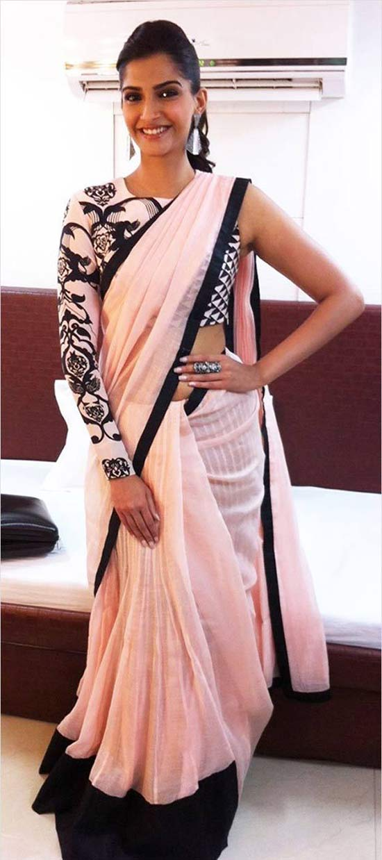 Sonam Kapoor in a pink and black Saree