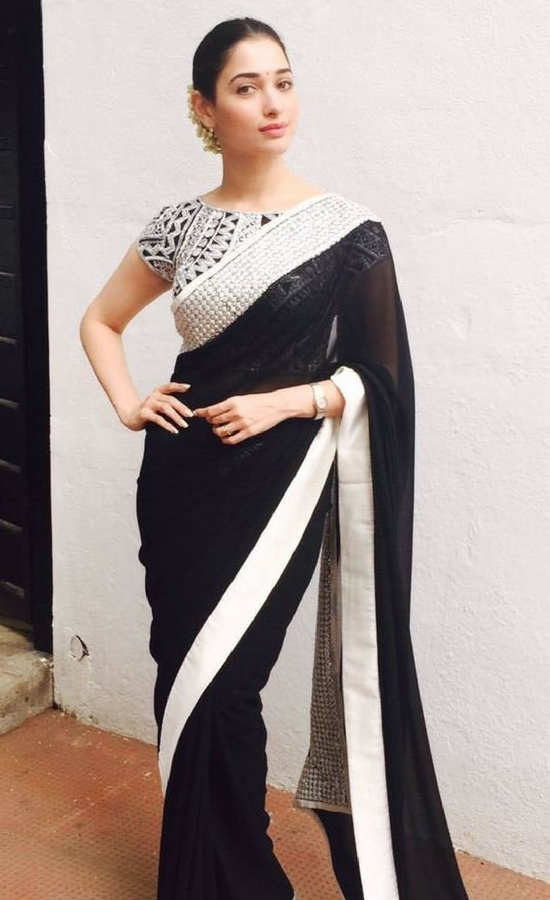 Tamanna Bhatia In black georgette saree edged with sequins and satin borders