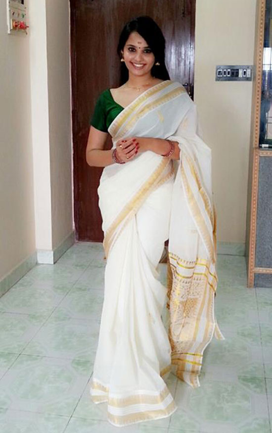White Kerala Saree And Green Blouse With Diamond Neckline