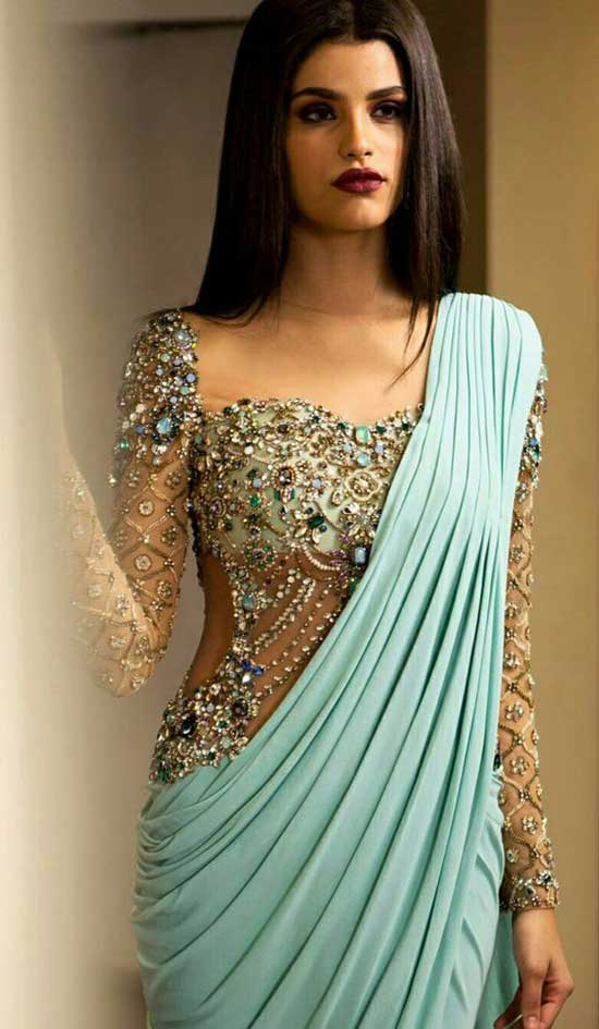Jeweled Sparkly Top With The Sleek Fabric On Aqua Colored Saree Gown