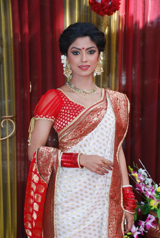 White Saree With Red Zari Border Paired With Sheer Puff Sleeves