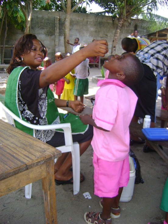 Students enrolled in our pilot health project like this child also received Vitamin A supplements as part of the program.