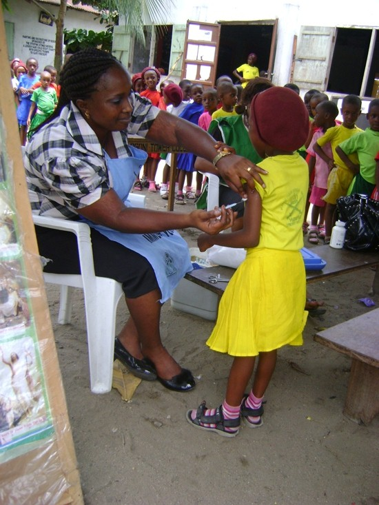 Our health project targeted 100 of the poorest and most vulnerable students in Bodo. The nurse here is giving one of our students a measles immunization.