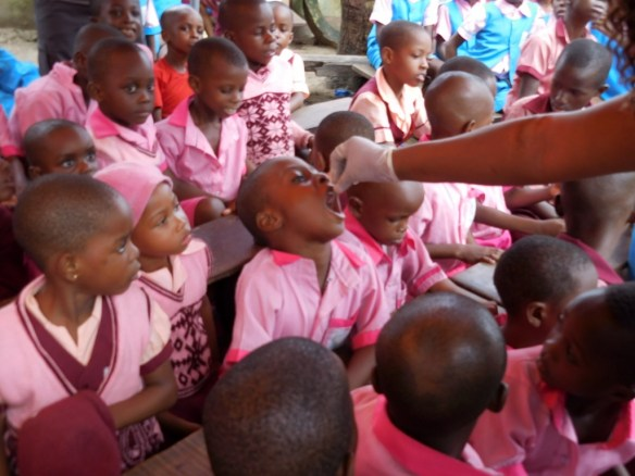 Bodo students receiving Vitamin A supplements in July 2015.