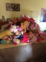 These are her stuffed animals, piled on our Queen size bed and this isn't even all of them.