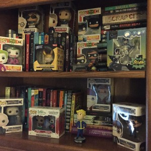 This is my tiny bookshelf, I had already informed my husband that I need a bigger one since all my funkos and my books don't fit on these two tiny little shelves. He didn't say no but that is because I control the checking account. ;)