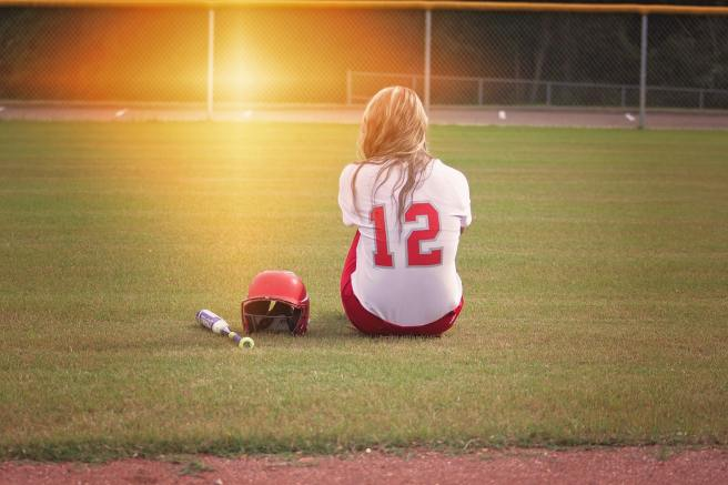 softball player seated