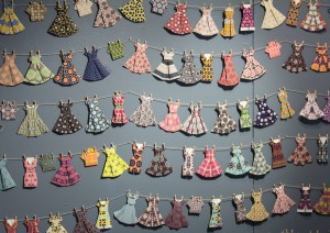 Well Dressed. 144 origami paper dresses folded from patterns created by workshop participants.