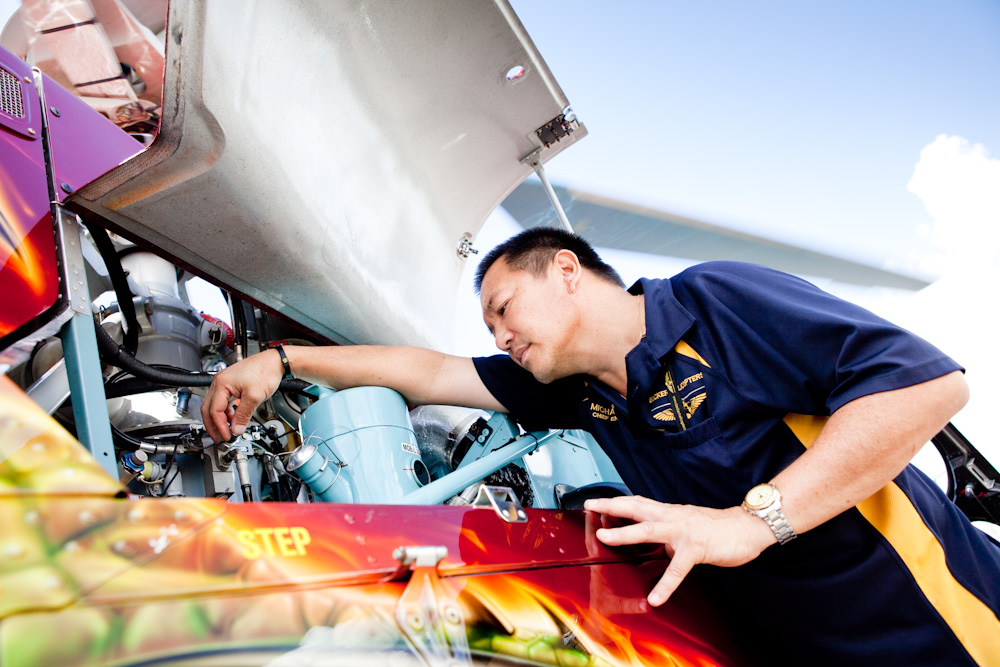 Director of Maintenance, Michael Yip, inspecting the engine bay of AS350D Squirrel Helicopter