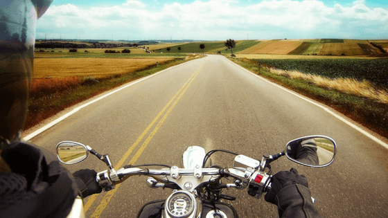 Motorcyclist riding on road