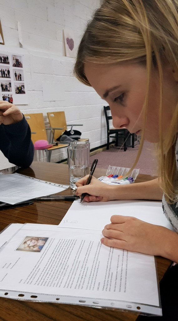 Ellie working hard - Who Killed Sally, escape room by NH Events, review by BeckyBecky Blogs