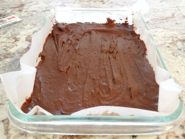 brownie batter placed in prepared pan