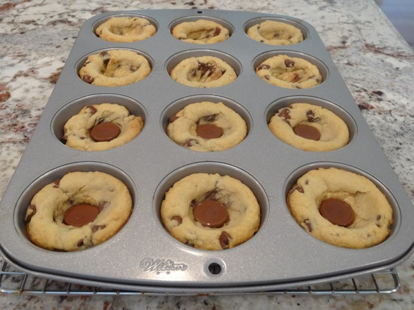 Adding center filling to chocolate chip cookie cups