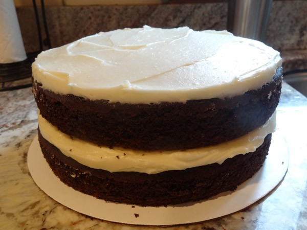 second layer of frosting added to cake