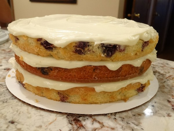 cream cheese frosting added to layered cake