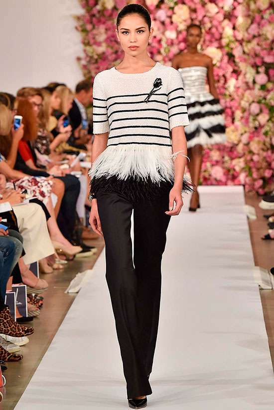 30 Chic Work Outfits to Wear this Summer: Model wearing a stripe feather hem sweater, black suit pants and black patent heels. Work outfits, summer work outfits, office wear, business casual, fashion, street style, womens fashion.