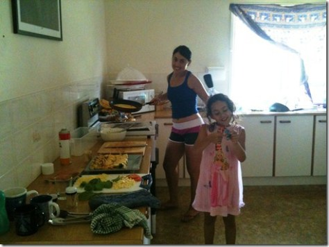 Sanna and Basma cooking omelettes in the kitchen for everyone.