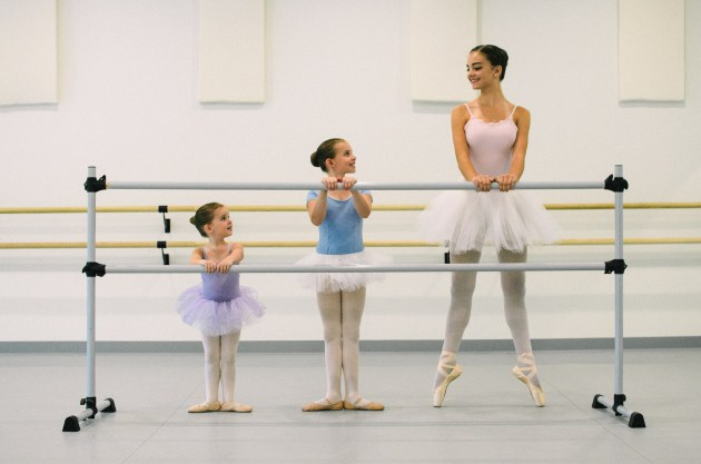 Younger Brass City Ballet students, left and center, Ella and Savannah Gould of Wolcott, watch Deanna Pietrorazio of Middlebury demonstrate en pointe, a ballet position in which the body is balanced on the extreme tip of the toe.  (Photo credit Paulina Pietrorazio
