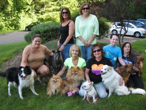 Middlebury Dog Park Committee members and their dogs, front, left to right, Louis Yager with Maverick (owned by Mary Lou Arnson) and Ryla (held by Dianne Vagnini, rear), Beverly Dassonville with Chloe and Wylie, Mary Lou Arnson with Lily and Tinkerbelle, Benjamin Modeen with Ollie and Julie Modeen with Otto and rear right, Nancy Modeen, whose dog Cookie was at home, meet in Meadowview Park to walk their dogs. The group hopes to raise money for a Middlebury dog park where dogs can safely run off leash. (Marjorie Needham photo)