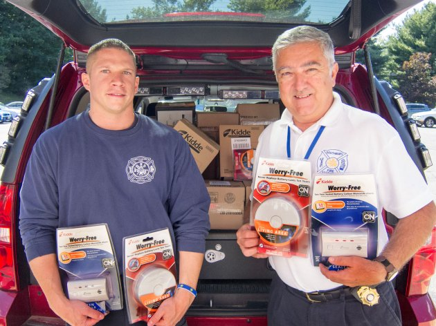 Southbury Deputy Fire Marshal Dan Tomascak, left, and Southbury Fire Marshal Barry Rickert, right, hold smoke and carbon monoxide detectors they acquired for Southbury residents at the Save a Life Initiative Wednesday. (Submitted photo)