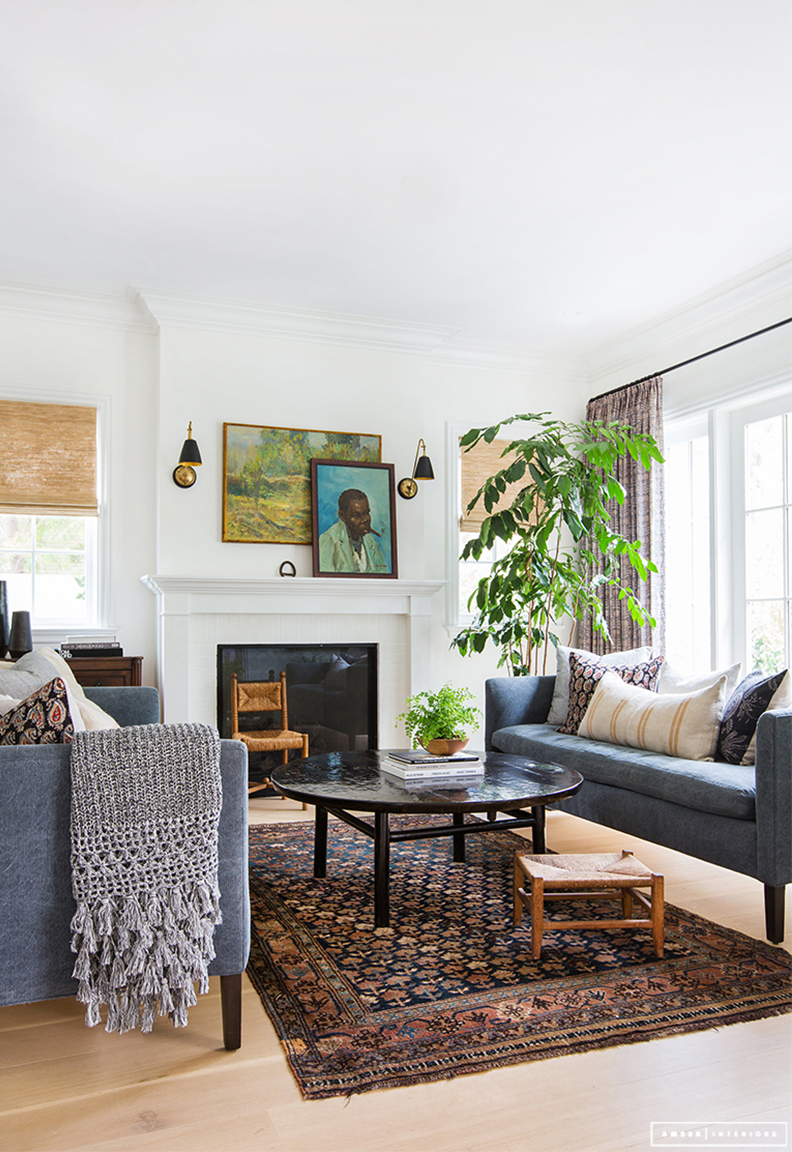 Amber Interiors living room design with two bench cushion sofas.