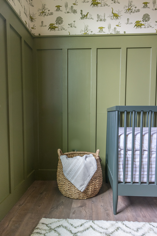 Baby boy Dino themed nursery with olive green crib by Beebout Design.