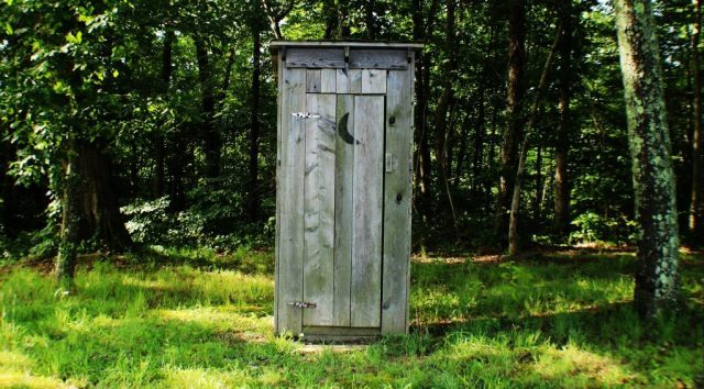 outside-wooden-toilet-cabine