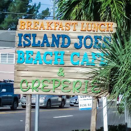 street sign for Island Joe's Beach Cafe