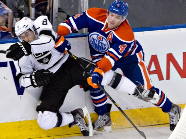 Los Angeles Kings' Drew Doughty, left, is checked by Edmonton Oilers' Taylor Hall during third period NHL hockey action in Edmonton, Alta., on Tuesday February 19, 2013. THE CANADIAN PRESS/Jason Franson.