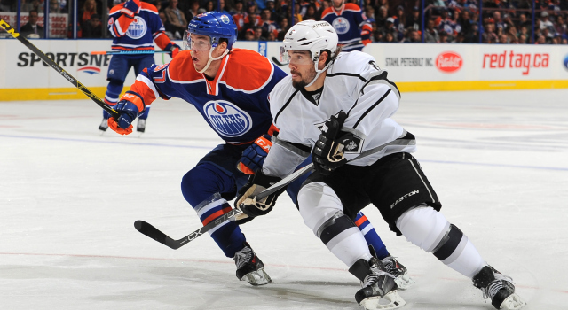 EDMONTON, AB - OCTOBER 25: Connor McDavid #97 of the Edmonton Oilers battles for the puck against Drew Doughty #8 of the Los Angeles Kings on October 25, 2015 at Rexall Place in Edmonton, Alberta, Canada. (Photo by Andy Devlin/NHLI via Getty Images)